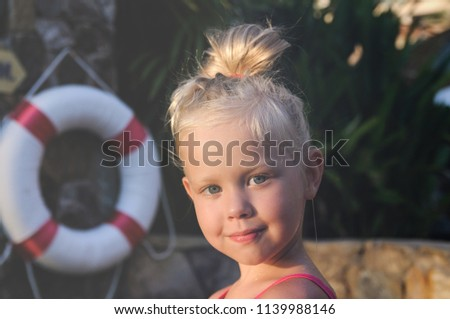 3e24c7244f9e Happy lifeguard with ring buoy lifebuoy. Woman girl supervising swimming  pool water on blue. portrait of a girl by the pool and a life ring in the  ...