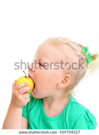 portrait of a girl child biting an apple