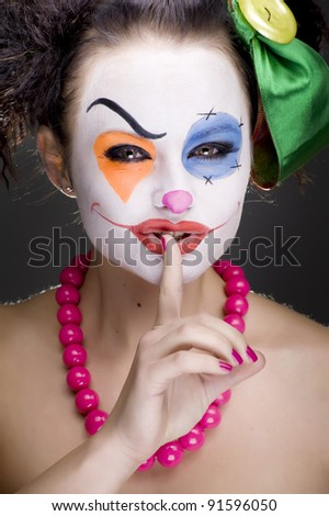 portrait of a girl clown with painted face.