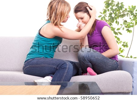 portrait of a girl comforting her sad friend