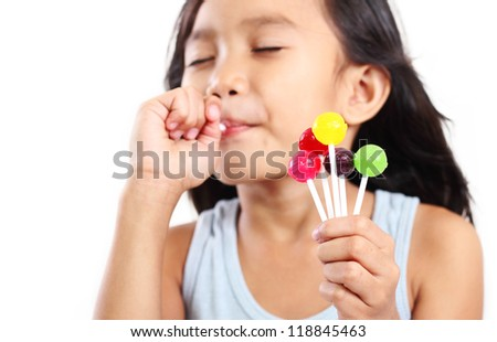 Portrait of a girl eating a lollipop.