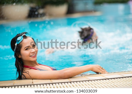 Portrait of a girl having fun in the swimming pool