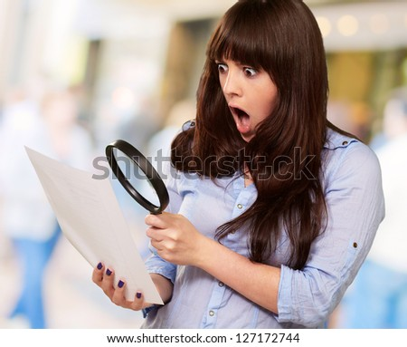 Portrait Of A Girl Holding A Magnifying Glass And Paper, Outdoor