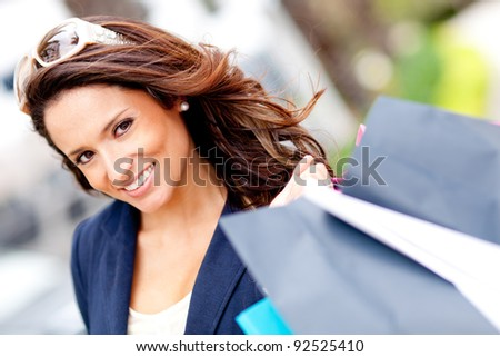 Portrait of a girl holding shopping bags and smiling