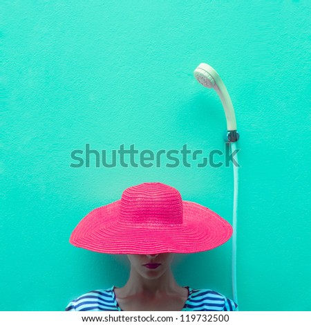 portrait of a girl in a hat in the shower