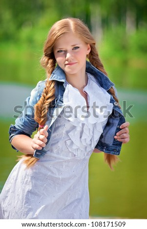 portrait of a girl in a white dress and denim jacket