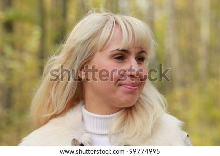 Portrait of a girl in an autumn wood - stock photo