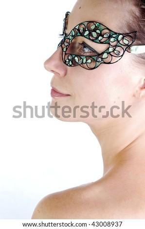 Portrait of a girl in green venetian mask
