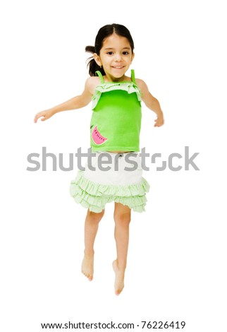 Portrait of a girl jumping and smiling isolated over white