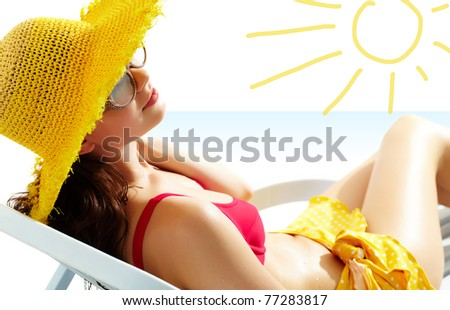 Portrait of a girl lying in the sun in chaise lounge