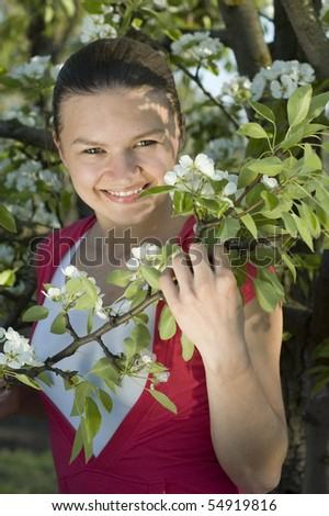 portrait of a girl on the background of a flowering tree