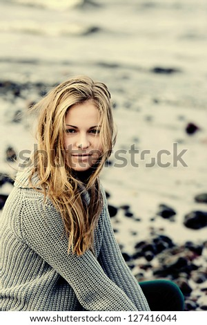 Portrait of a girl on the waterfront
