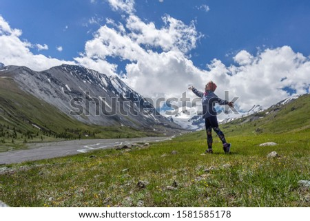 Portrait of a girl outdoors, outdoor sports activity in the mountains, traveling in the Altai, mountain hiking.bject]