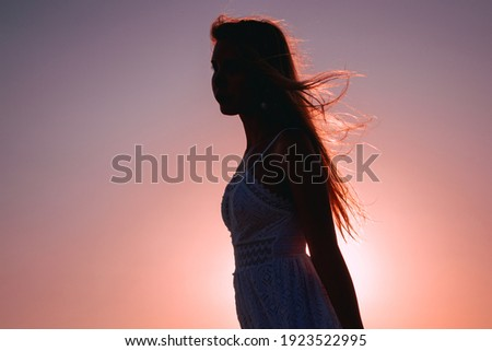 portrait of a girl's silouette on sunset Stock photo ©
