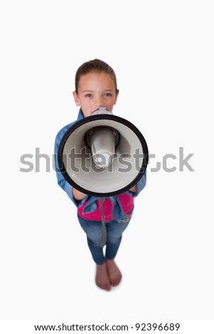Portrait of a girl speaking through a megaphone against a white background
