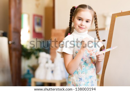 portrait of a girl standing next to his easel, a drawing lesson