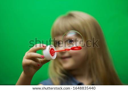 Portrait of a girl through a soap bubble