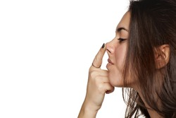 portrait of a girl who raises her nose with a finger