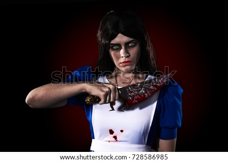 Stock Photo Portrait of a girl with a knife, Cosplay from a video game Alice Madness returns