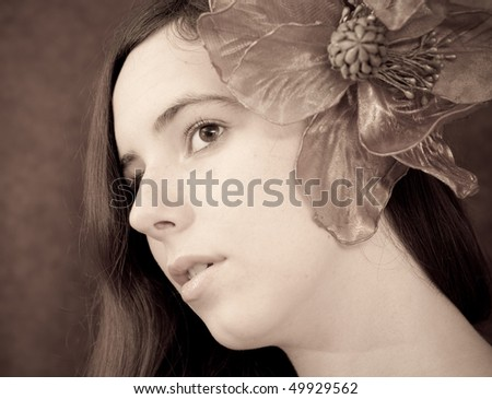 Portrait of a Girl with a Large Flower in Ear