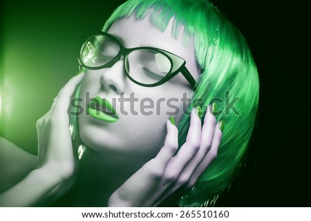 Portrait of a girl with bright makeup and colorful hair