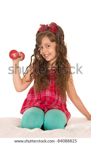 portrait of a girl with dumb bells on bed
