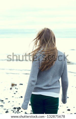 Portrait of a girl with hair fluttering in the wind