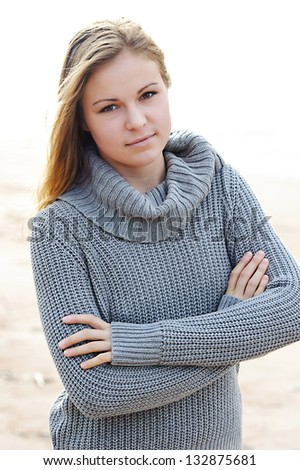 Portrait of a girl with hair fluttering in the wind - stock photo