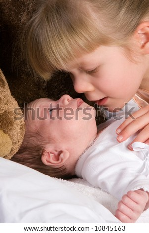 Portrait of a girl with her newborn brother