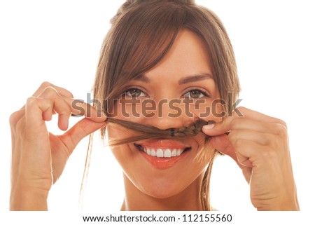 Portrait of a girl with moustache made of pigtail on isolated white