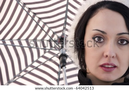 portrait of a girl with open umbrella