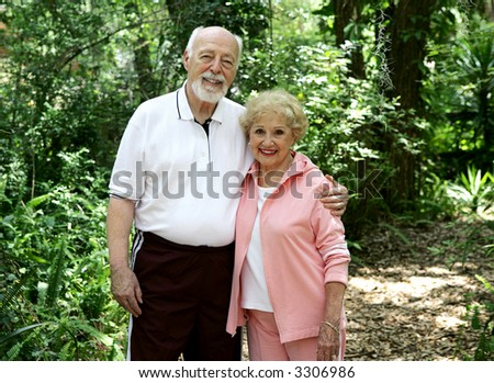 Portrait of a good looking, active senior couple taking a walk in the park.