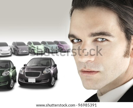 portrait of a good looking car salesman in close up view against background of luxury bright car. Black Bedroom Furniture Sets. Home Design Ideas
