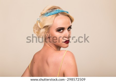 Portrait of a gorgeous blonde. The mystery, sadness, insecurity, human emotions. The girl in the style of the 20s.