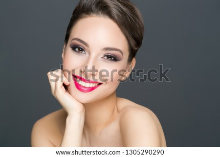 Portrait of a gorgeous brunette in elegant makeup.