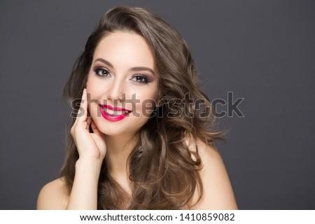 Portrait of a gorgeous brunette in elegant makeup. #1410859082