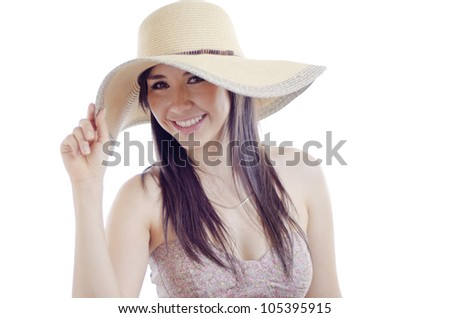 Portrait of a gorgeous latin woman with a hat and a summer dress