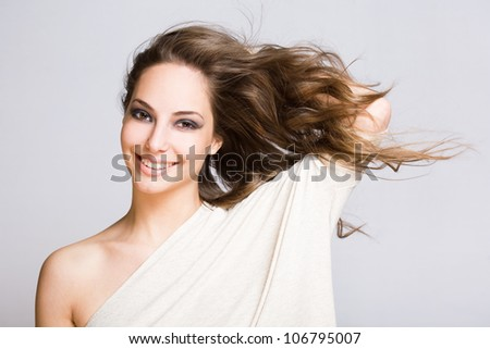 Portrait of a gorgeous relaxed young brunette woman.