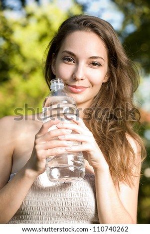 Portrait of a gorgeous young brunette woman enjoying cool clean water.
