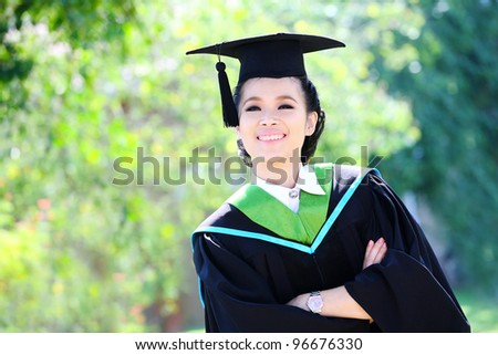 Portrait of a graduation student looking up outdoors