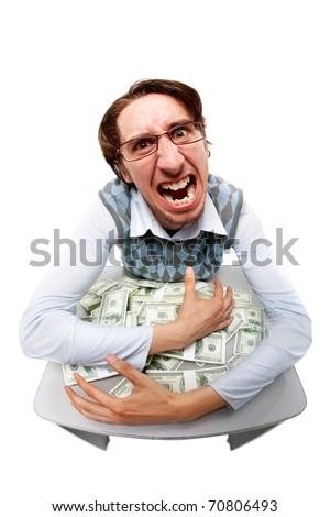 Portrait of a greedy man hiding his money - stock photo