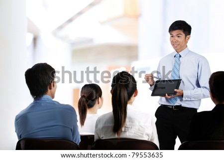 Portrait of a group of Asian businesspeople in meeting