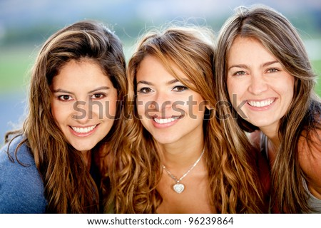 Portrait of a group of beautiful female friends smiling #96239864