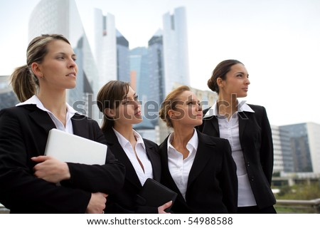 Portrait of a group of businesswomen in suit looking away