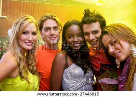 Portrait of a group of party people at a bar