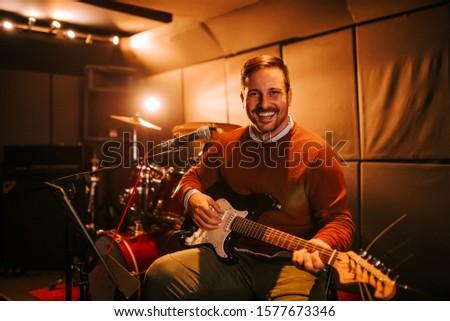 Portrait of a guitarist in the studio.