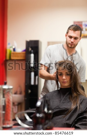 Portrait of a hairdresser blowing hair of a customer