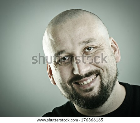 portrait of a half bald man
