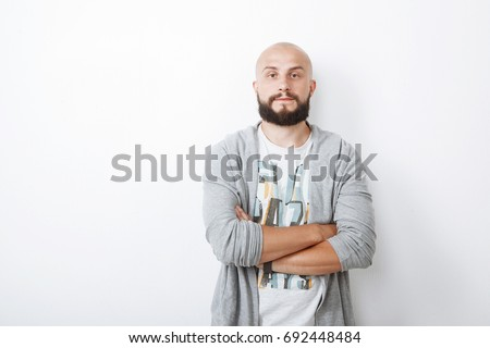 Portrait of a Handsome bold man with beard on white background
