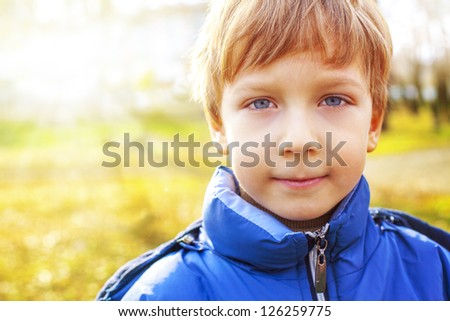 portrait of a handsome boy on a background of nature - stock photo
